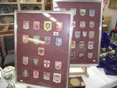 2 framed displays of European cloth tourist patches