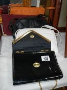 A quantity of vintage handbags.