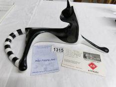 A boxed Cmielon porcelain sculpture entitled 'Kotka Lezaca' (1959) 403/2001,