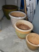 A quantity of old garden planters.
