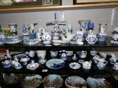2 shelves of Delft hand painted pottery, some a/f.