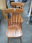 A pair of pine chairs