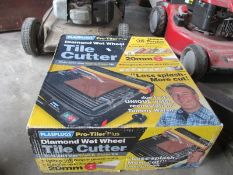 A boxed tile cutter