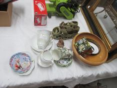 A soapstone group a/f and three Burslem Brama cups and saucers