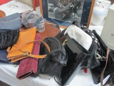 A large quantity of purses and handbags