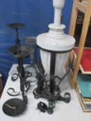 A quantity of wrought iron cndle stands etc