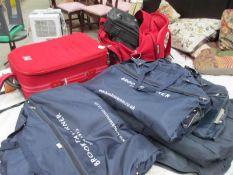 A quantity of suit bags,