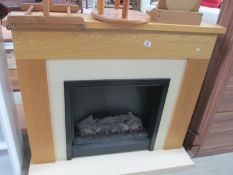 Two electric fires with surrounds