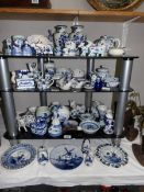 A large quantity of Delft hand painted items including salt and pepper pots.