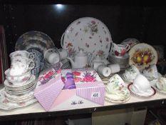 A shelf of tea ware including Royal Doulton trio, Royal Albert part tea set etc.