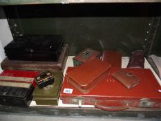 A mixed lot of leather cases, money saving tins, vanity cases etc.