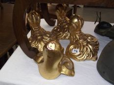 4 gilded plaster ball and claw wall mounts.