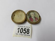 A 19th century miniature portrait painting of a gentleman in case,