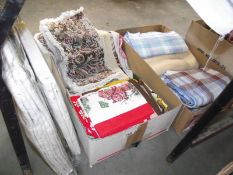 A large mixed lot of tablecloths, tea towels, cushion covers etc.