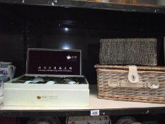 A boxed oriental tea-mill tea set and 2 wicker baskets.