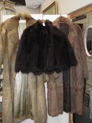 2 fur coats and a fur cape.