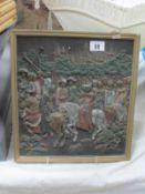 A relief plaque featuring Tudor scene