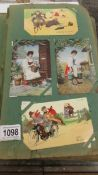 A large album containing an interesting collection of early humorous postcards,