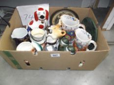 A mixed lot of pottery including character jugs, Jersey cow creamer etc.