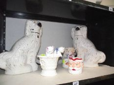 A pair of Victorian Staffordshire spaniels, continental cats in basket etc., all items a/f.