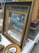 A fire screen and picture frames