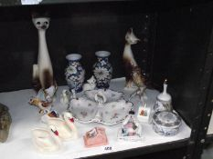 A mixed lot of continental pottery and porcelain, crested ware, fairing etc.