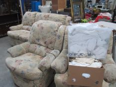 A three piece suite including one electric recliner