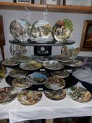 Approximately 36 Doulton and Wedgwood plates including Cries of London, Country Days etc.