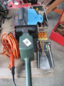 An electric hedge trimmer,