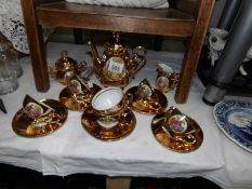 An 18 piece gilt J K W Karlsbad porcelain tea set.