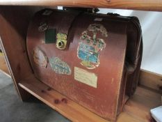 An old leather briefcase and contents