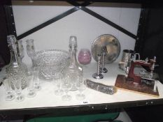 A quantity of glass decanters, silver backed brush, sewing machine etc.