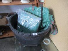 A plastic faux wood barrel planter etc