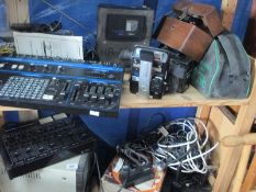 Two shelves of electrical equipment including an audio mixer,