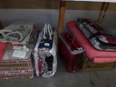 A quantity of bedding including bedspreads.