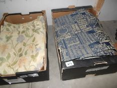 A pair of curtains with matching door curtain and another pair of curtains,.