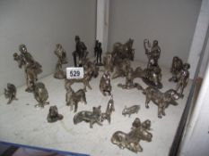 A mixed lot of silver plate figures and animals.