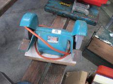 A Black and Decker bench grinder