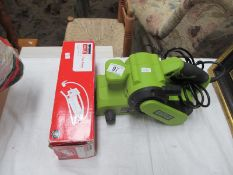 A Guilo electric planer and a boxed foot pump