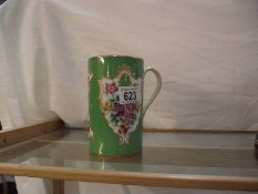 A 19th century continental porcelain hand painted tankard.