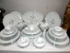 In excess of 60 pieces of Japanese tea and dinner ware marked R C on base. (collect only).