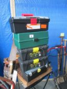 A quantity of toolboxes some with tools