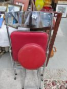 A chromed metal seat and a stool