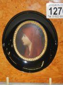 A fine miniature portrait in a walnut frame.
