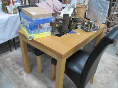 A dining table and 4 leather chairs