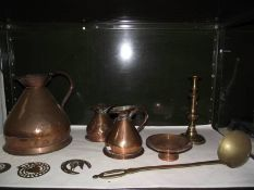 A mixed lot of brass and copper including graduated jugs.