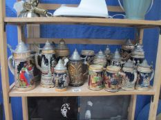 A collecion of approximately 18 German tankards / Steins