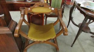 A mahogany chair with X stretcher base.