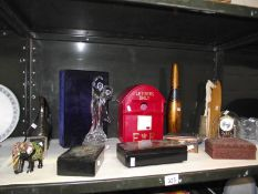 A shelf of miscellaneous including lacquered boxes, glass dancers, figure etc.