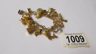 A 9ct gold charm bracelet with charms, 34 grams. (re-entered due to non paying bidder).